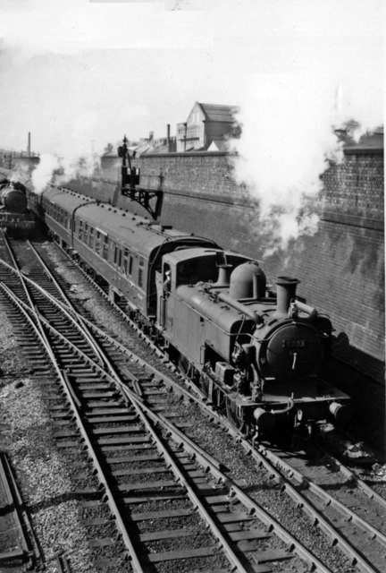 Old Oak Common East: a '9700' class 0-6-0PT sets off for Paddington, while a light engine returns to the Locomotive Depot.