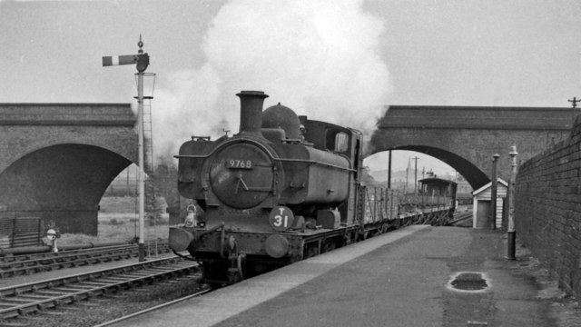 Down goods train passing under the LMR viaduct at Dunstall Park station