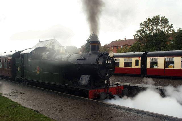 """""""Poppy Line"""" steam train service leaving Sheringham Station"""