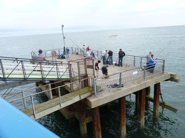 Fishing off  the pier landing stage, Llandudno