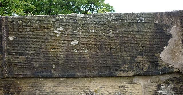 Defaced inscription, south parapet of Howebeck Bridge