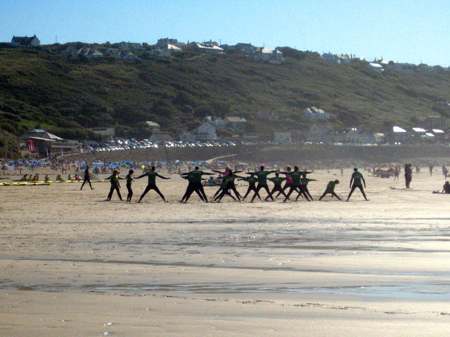 Trainee surfers carrying out their warm-up exercises on Sennen Beach