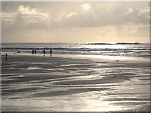 SW3526 : Figures on Sennen Beach at low tide by Rod Allday