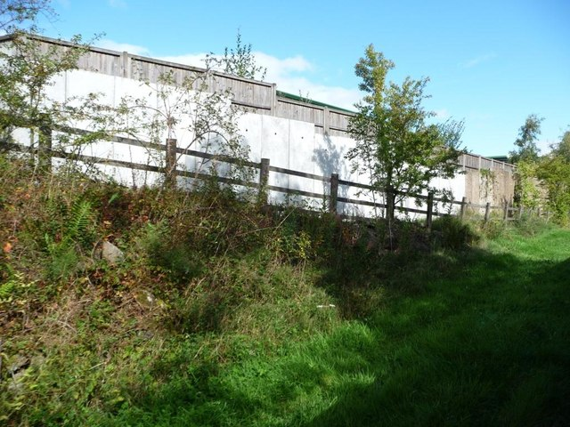 Footpath rising up from alongside railway line