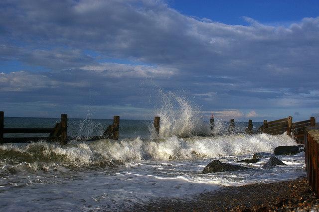 Incoming tide and sea defences, West Runton