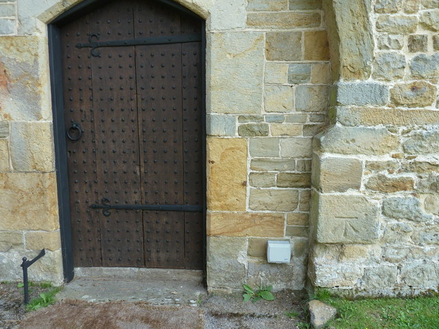Bench mark by the west door entrance to the tower