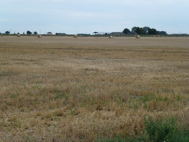Stubble field and distant farm near Goosetree, March