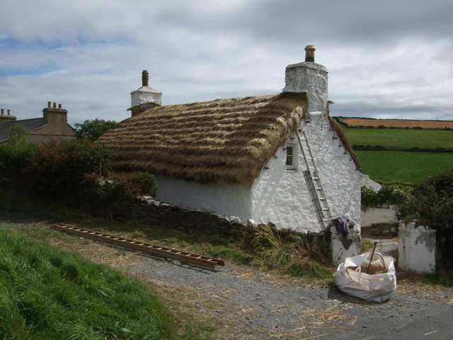 Cottage being re-thatched