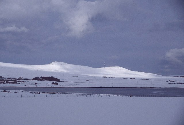 View from Voehead, Baltasound, towards the snowy Heogs