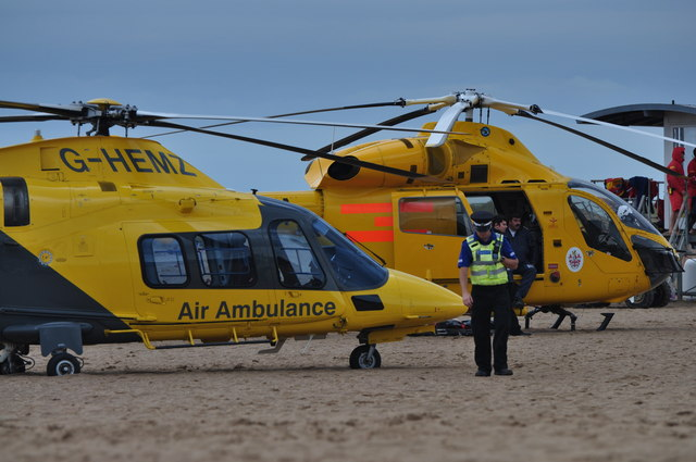 Two Air Ambulance Helicopters on beach
