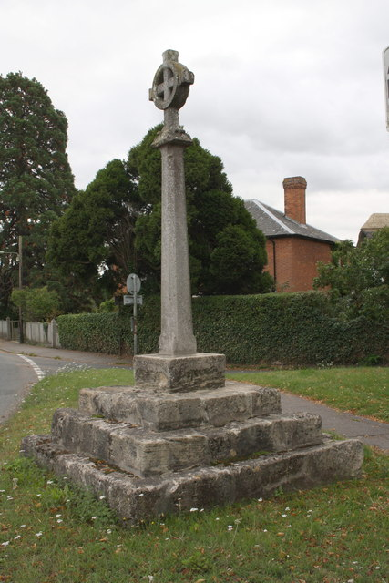Village cross with old benchmark on face of top step