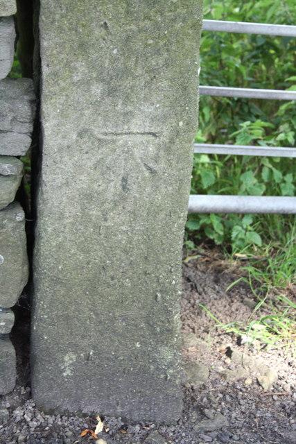 Benchmark on gatepost on east side of Skipton Road