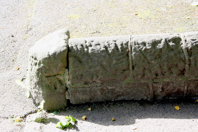 Benchmark on low wall at entrance to Bailey Cottage