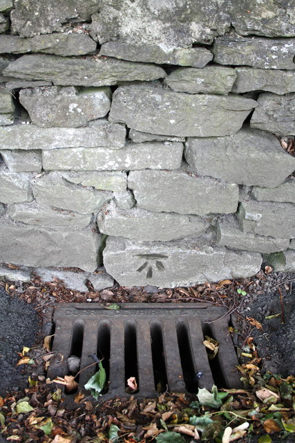 Benchmark on wall of The Bailey