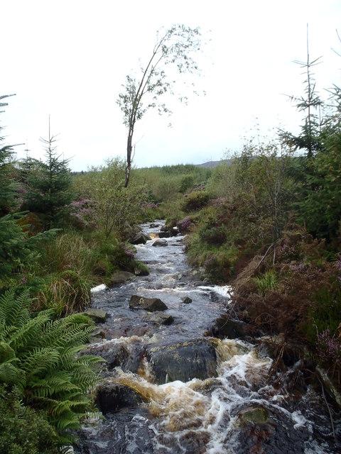 The peaty waters of the Glengainoch Burn