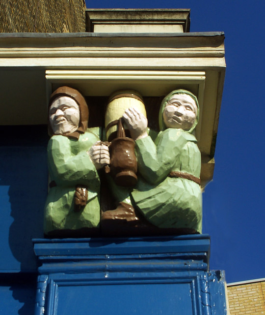 Wooden carved relief of drinkers, Forest Gate