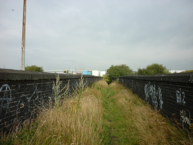 The path goes over a dismantled railway