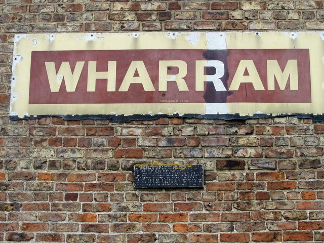Enamel station sign, relocated