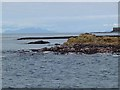 NM2640 : Tidal rocks at the south-west tip of Lunga by Oliver Dixon