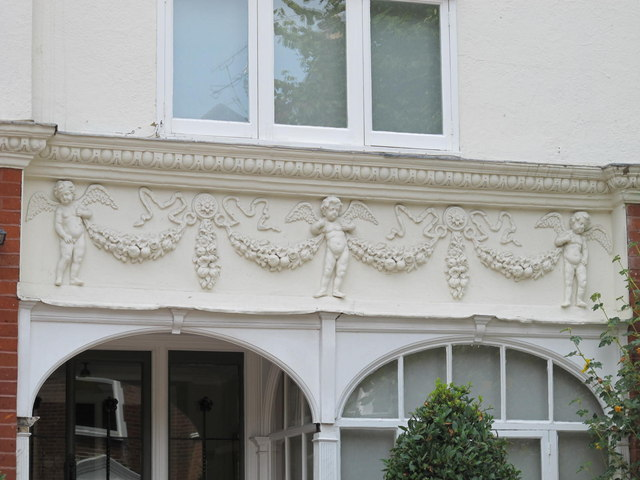 Pretty putti on a house in Blenheim Gardens, NW2