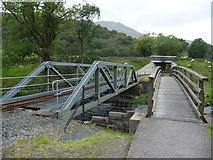 SH5947 : Footbridge and railway bridge over the Afon Glaslyn near Beddgelert by Jeremy Bolwell