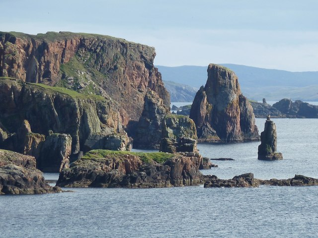 Red sandstone cliffs and stacks