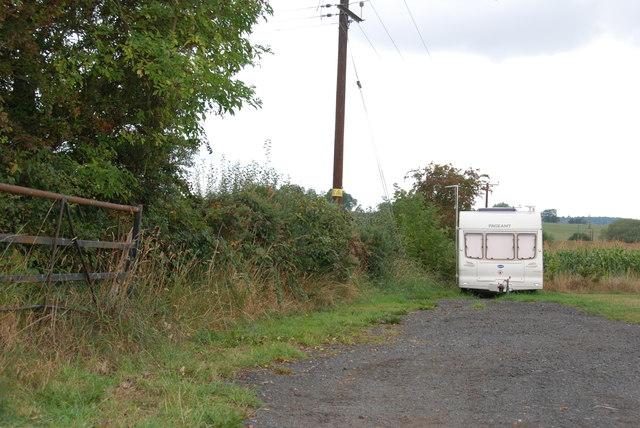 Caravan in Field Near White Sitch