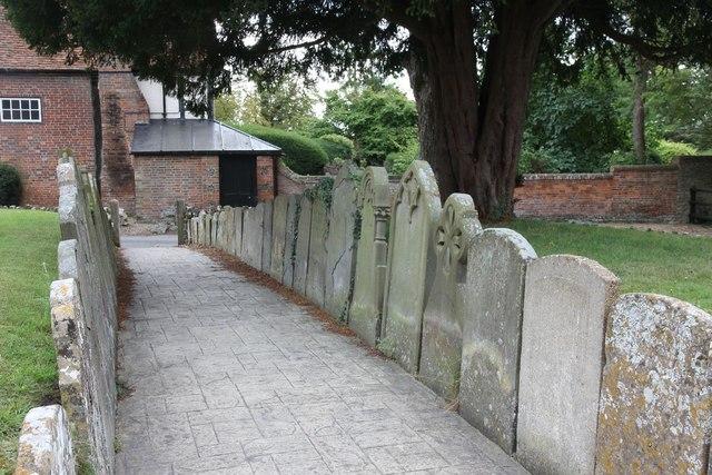 Headstones mark the path