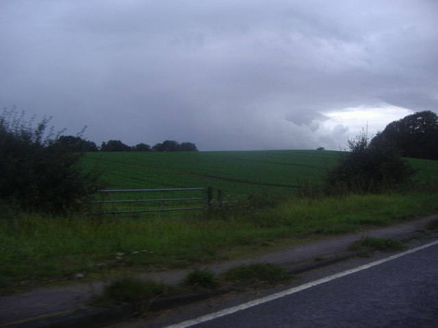 Storm clouds over the fields by Westerham Road