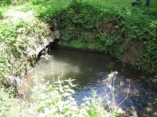 Old stone bridge and embankment on Candlestick Brook
