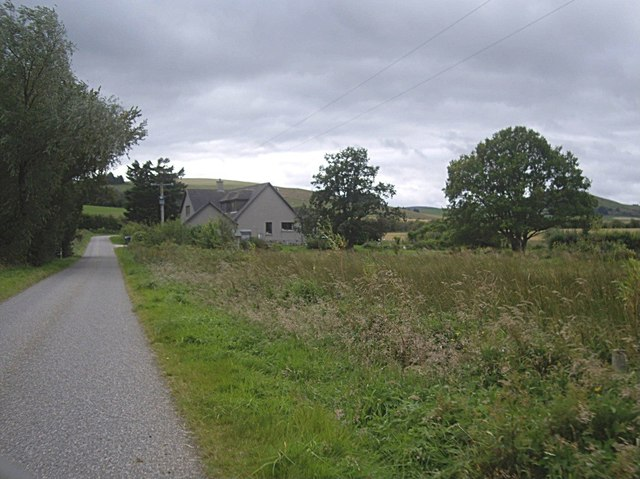 Cottage near a bend in the road