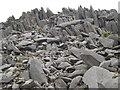 NY2406 : Rock outcrops below Bowfell summit by Peter S