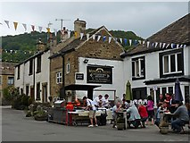 SK2276 : A hog roast outside The Miners Arms, Eyam by Robin Drayton