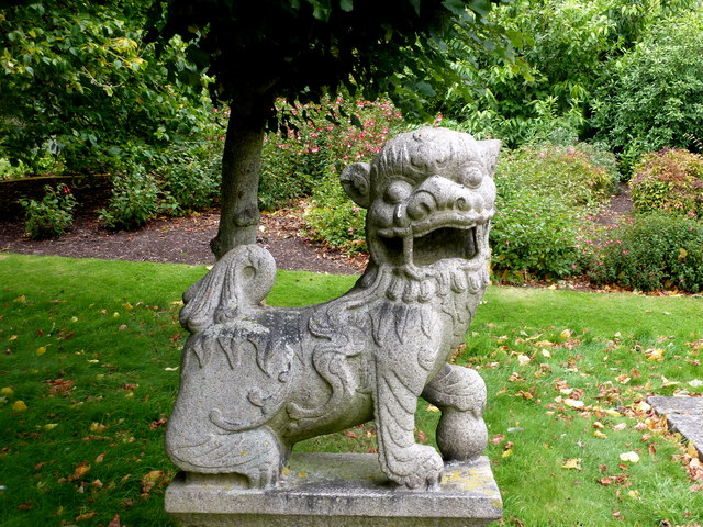 One of the two stone Chinese dogs that flank the Buddha statue in Sandringham grounds, Norfolk