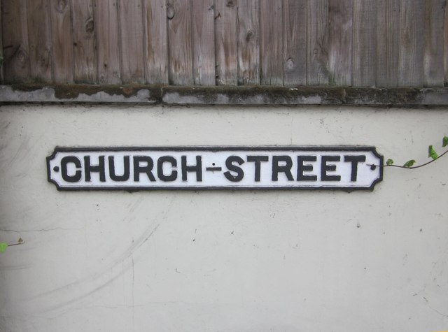 An old street name plate