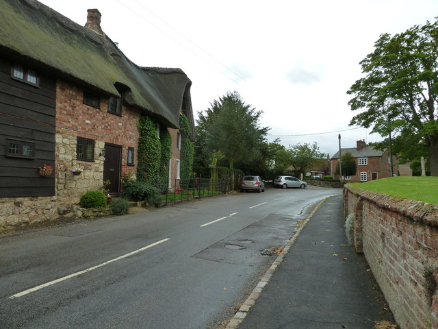 Thatched cottage opposite the parish church