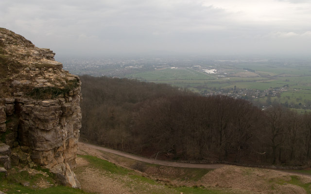 Rock outcrop with woodland below Cleeve Hill