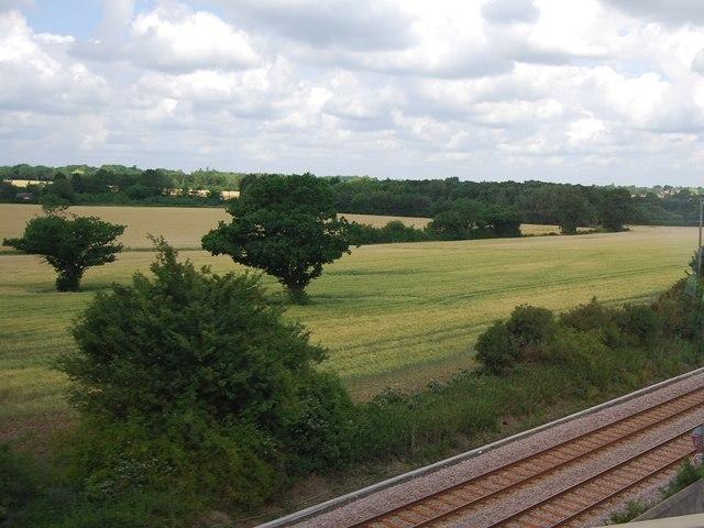 Farmland by the railway and A11