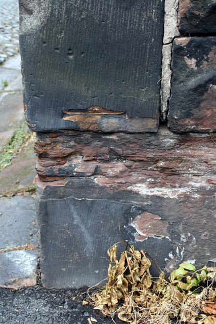 Eroded benchmark on wall in front of Baptist Church, Aglionby Street