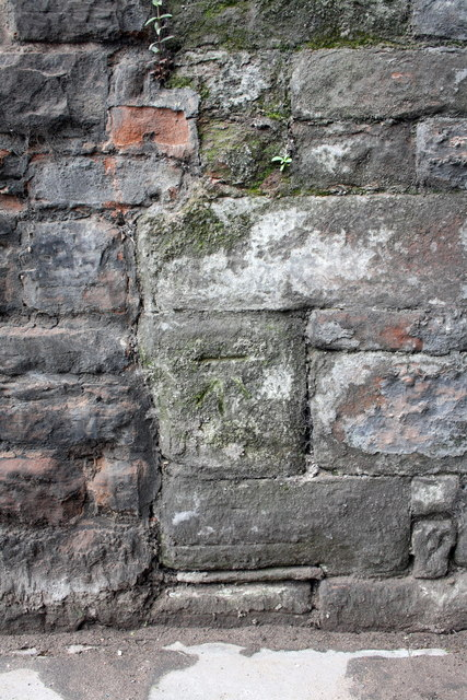 Benchmark on wall of Crown Street SW of railway