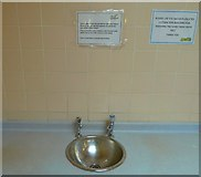 NS3321 : Do not wash your feet in the sinks by Andy Farrington