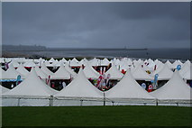 NZ3766 : The charity tents at the Great North Run by Bill Boaden