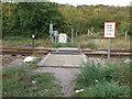 TQ7785 : Footpath crossing over railway by Roger Jones