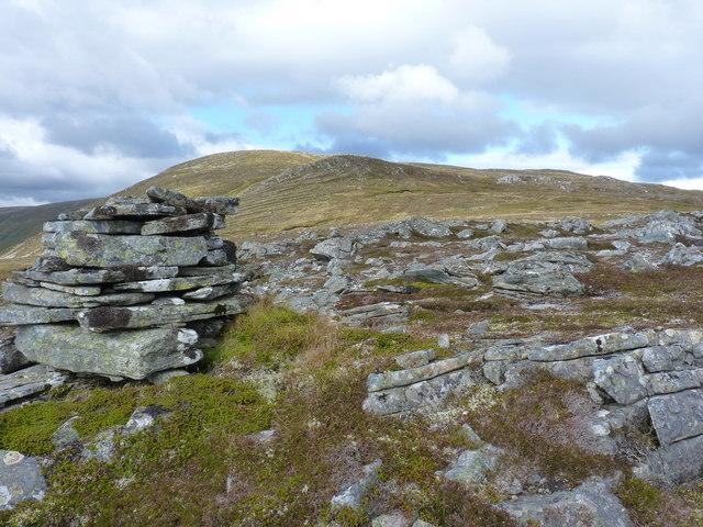 A small cairn on the lip of steep ground