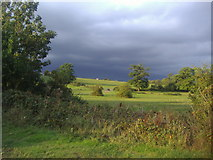TQ1564 : Dark clouds over the fields, Claygate by David Howard
