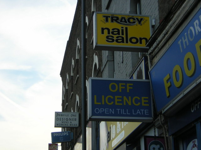 Shop-signs outside Thornton Heath Station
