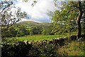 NY4226 : Wall and View of Little Mell Fell by Mick Garratt