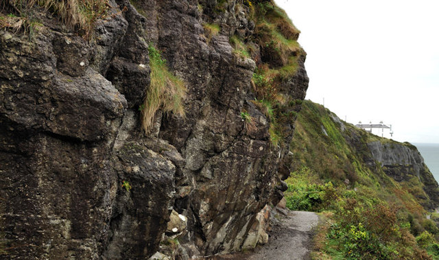 Cliff and lighthouse, Whitehead