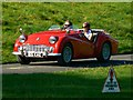 ST7475 : Red Triumph TR3A at 'Spirit of the 60s' 02 October 2011 Dyrham Park by Brian Robert Marshall