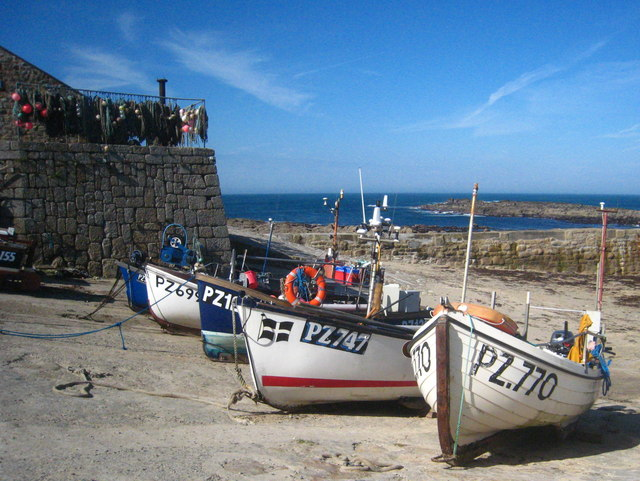 Boats lined on shore